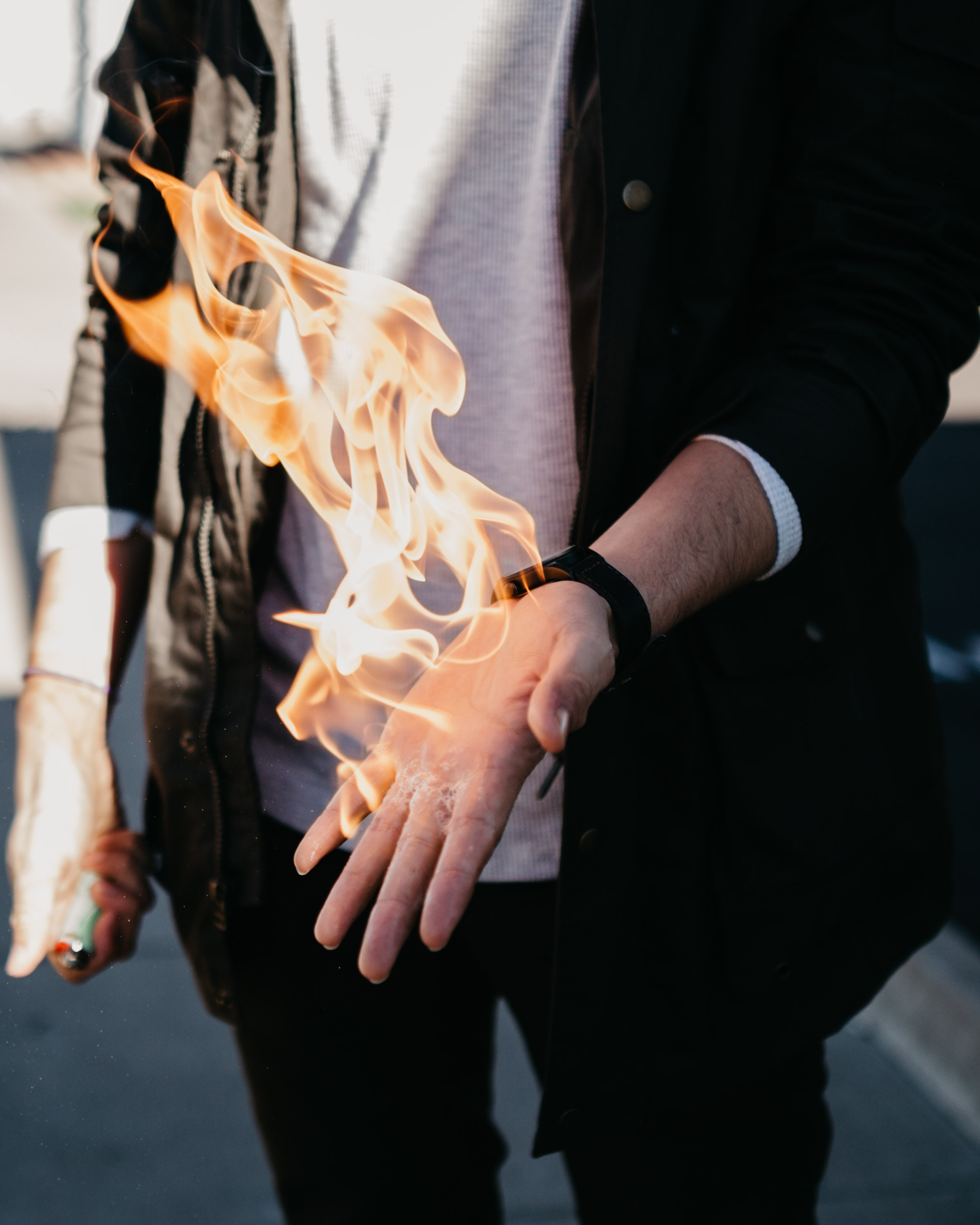 person with flaming hand