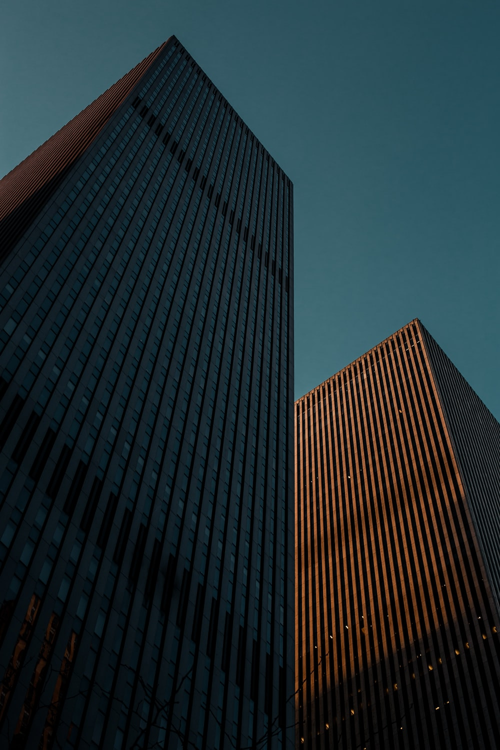 low angle photo of two high-rise buildings
