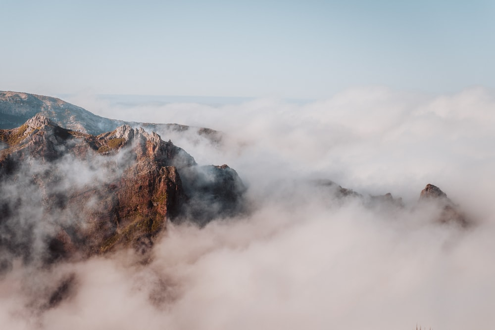 mountain with clouds during daytime
