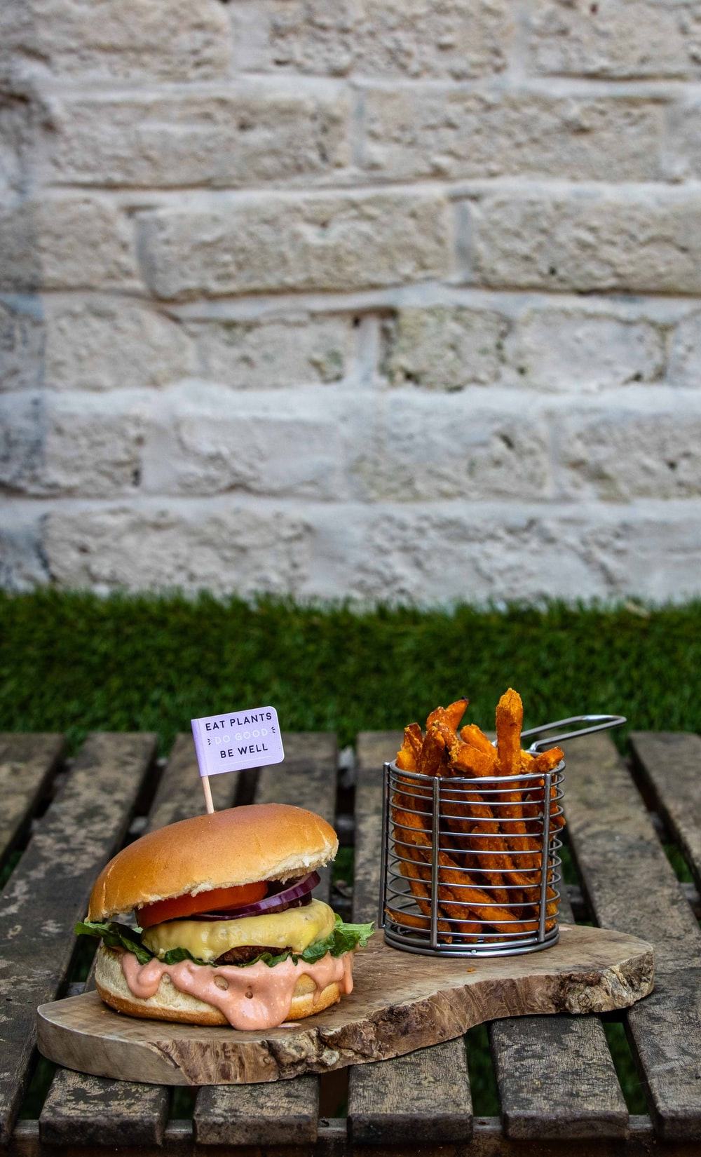 meat burger near basket of French fries