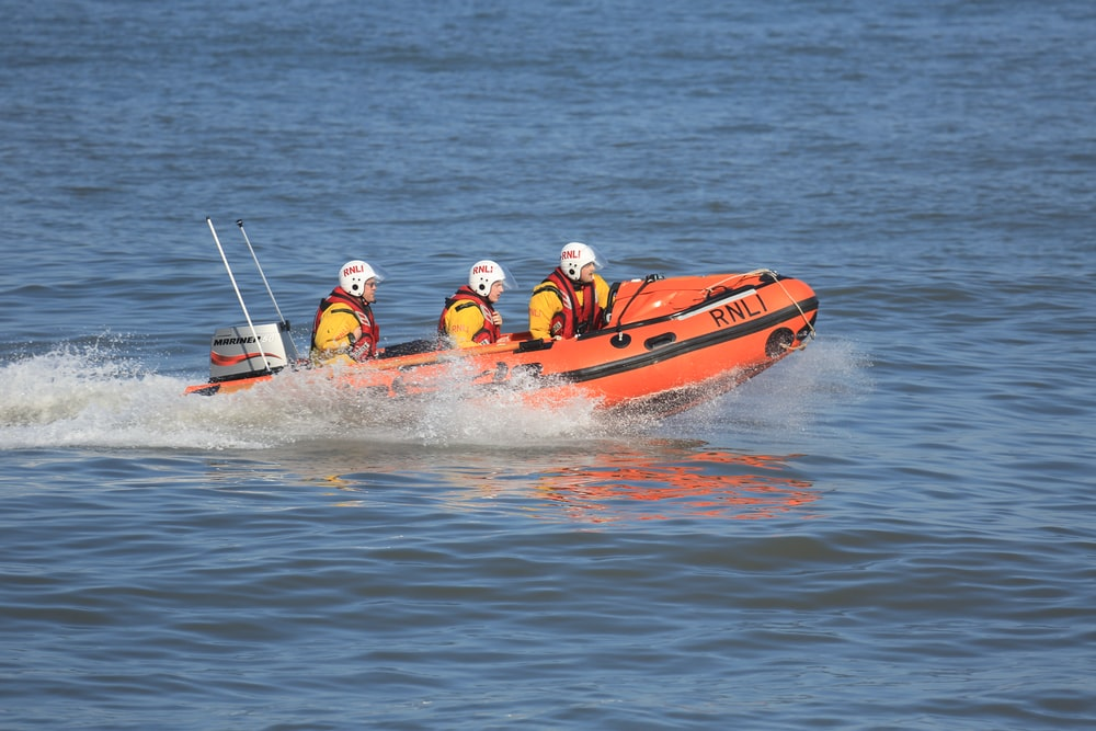 three people riding speedboat