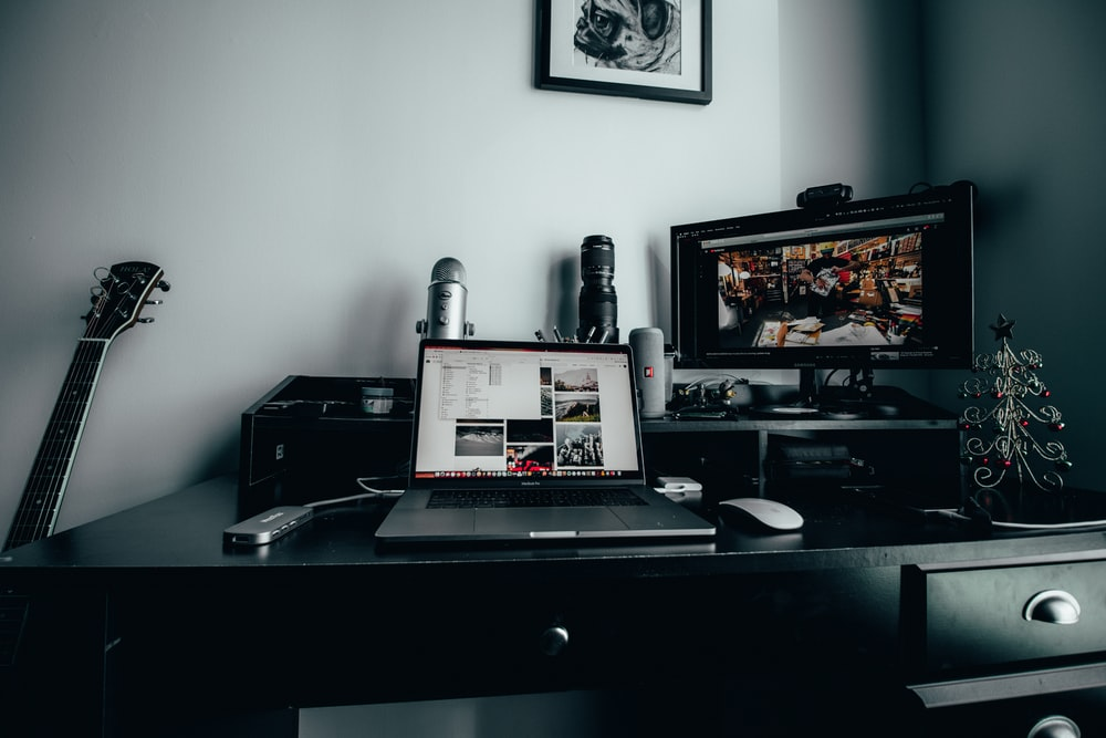 MacBook Pro, Magic Mouse, and monitor on desk