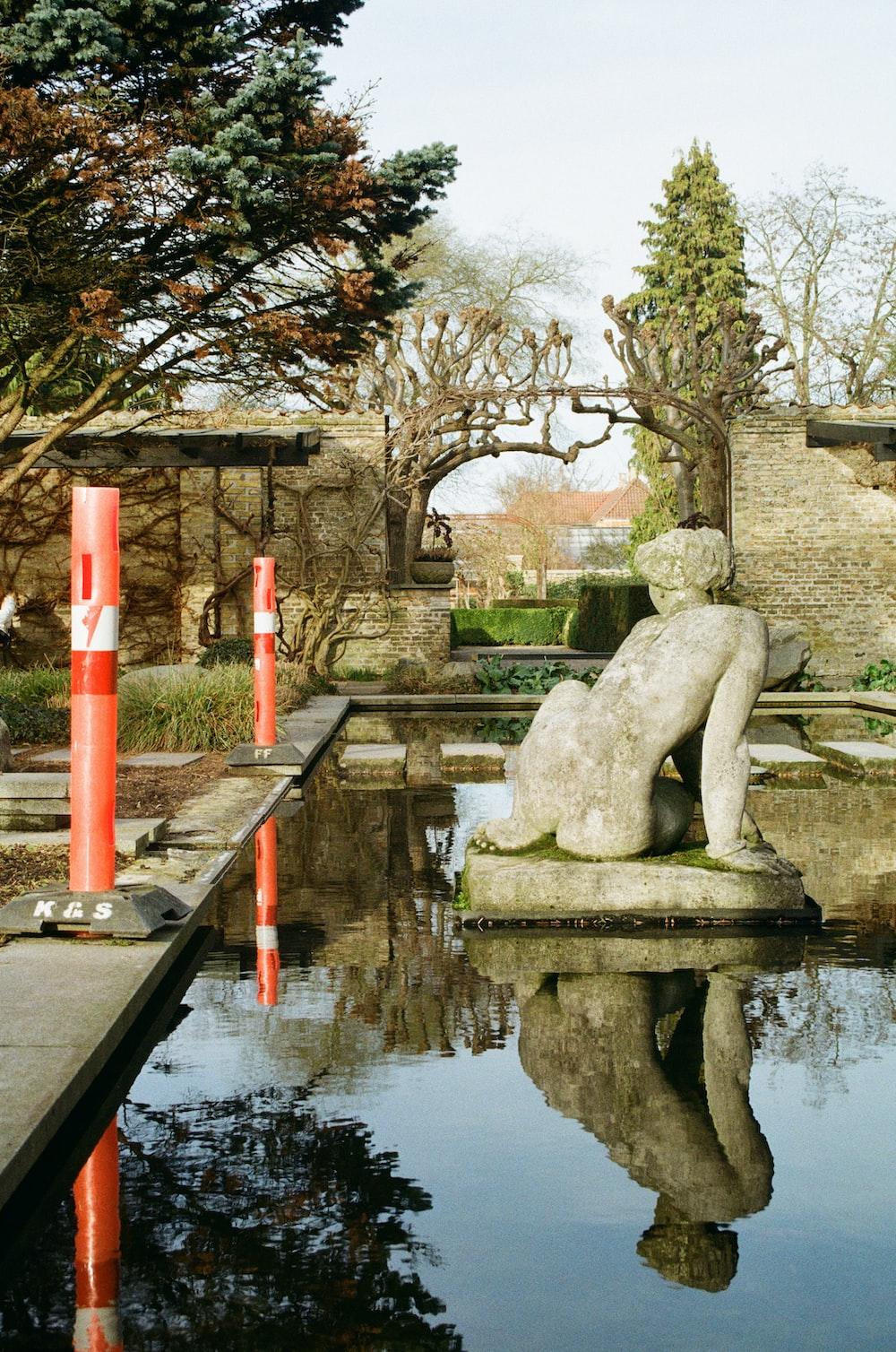 gray statue fountain decor