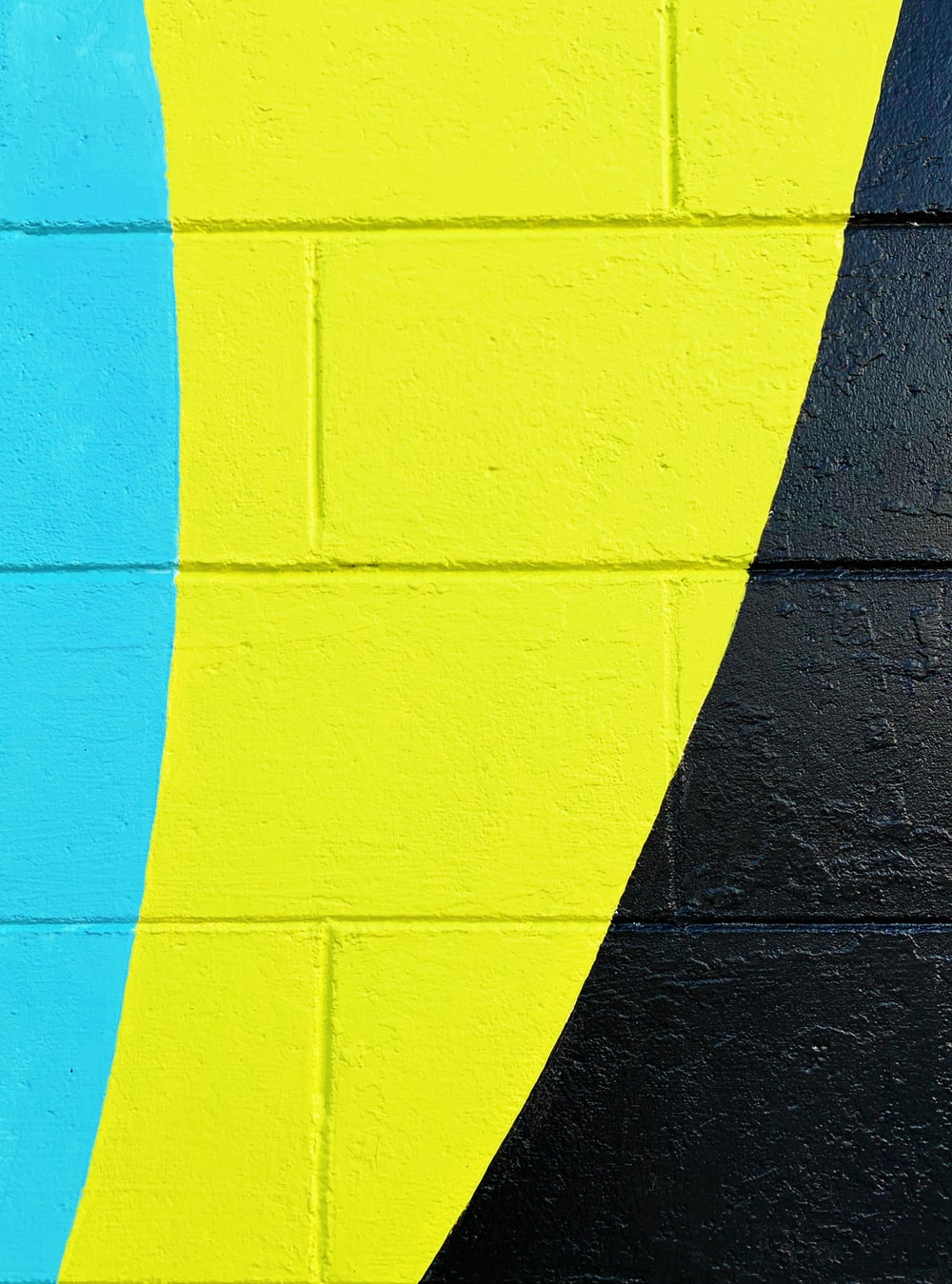 teal, yellow, and black painted wall