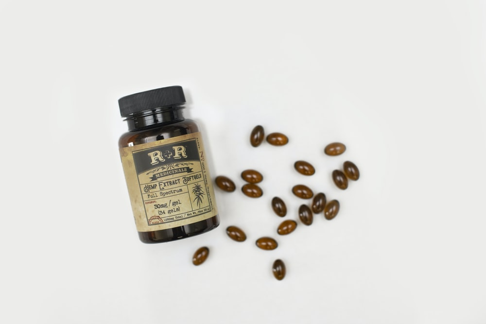 brown medicine pills and bottle