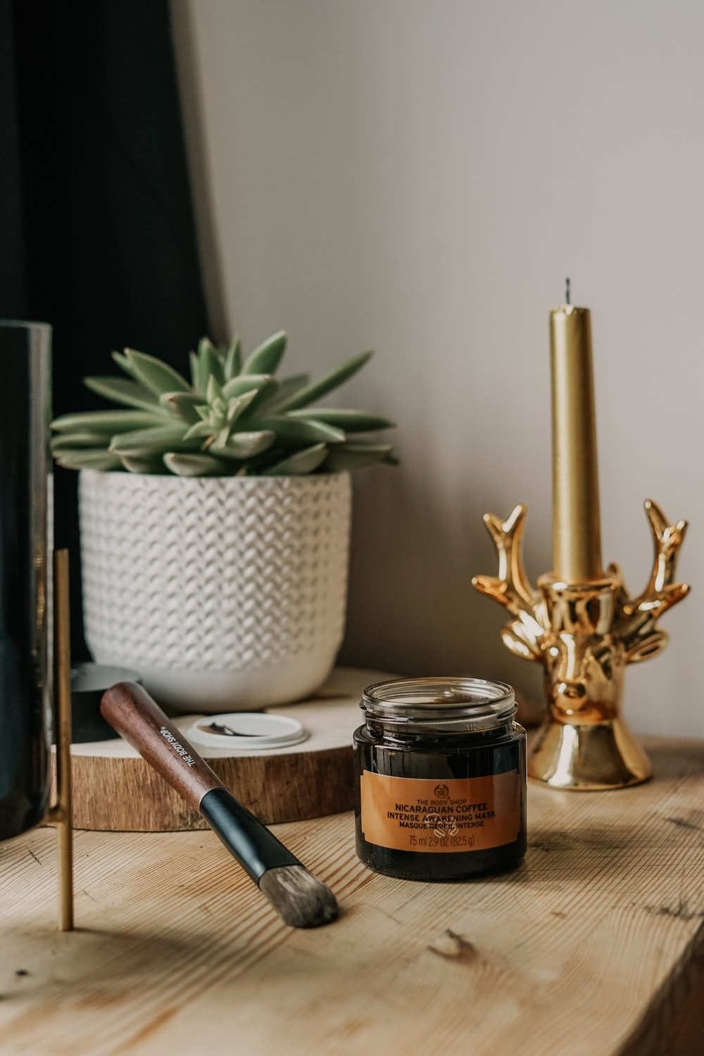 glass jar beside brown paint brush on table