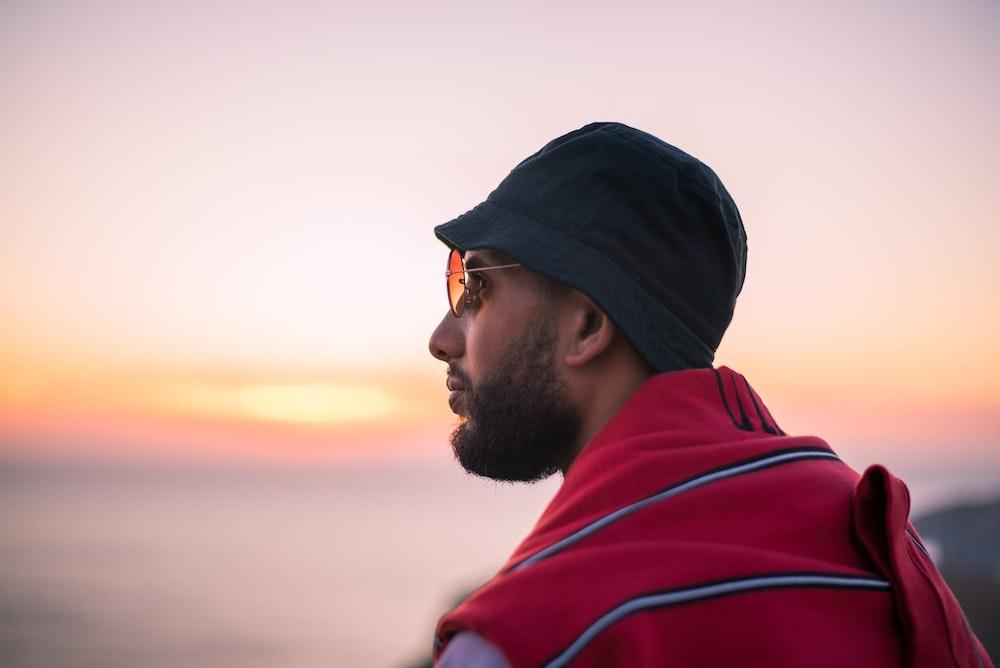 man wearing sunglasses and bucket hat