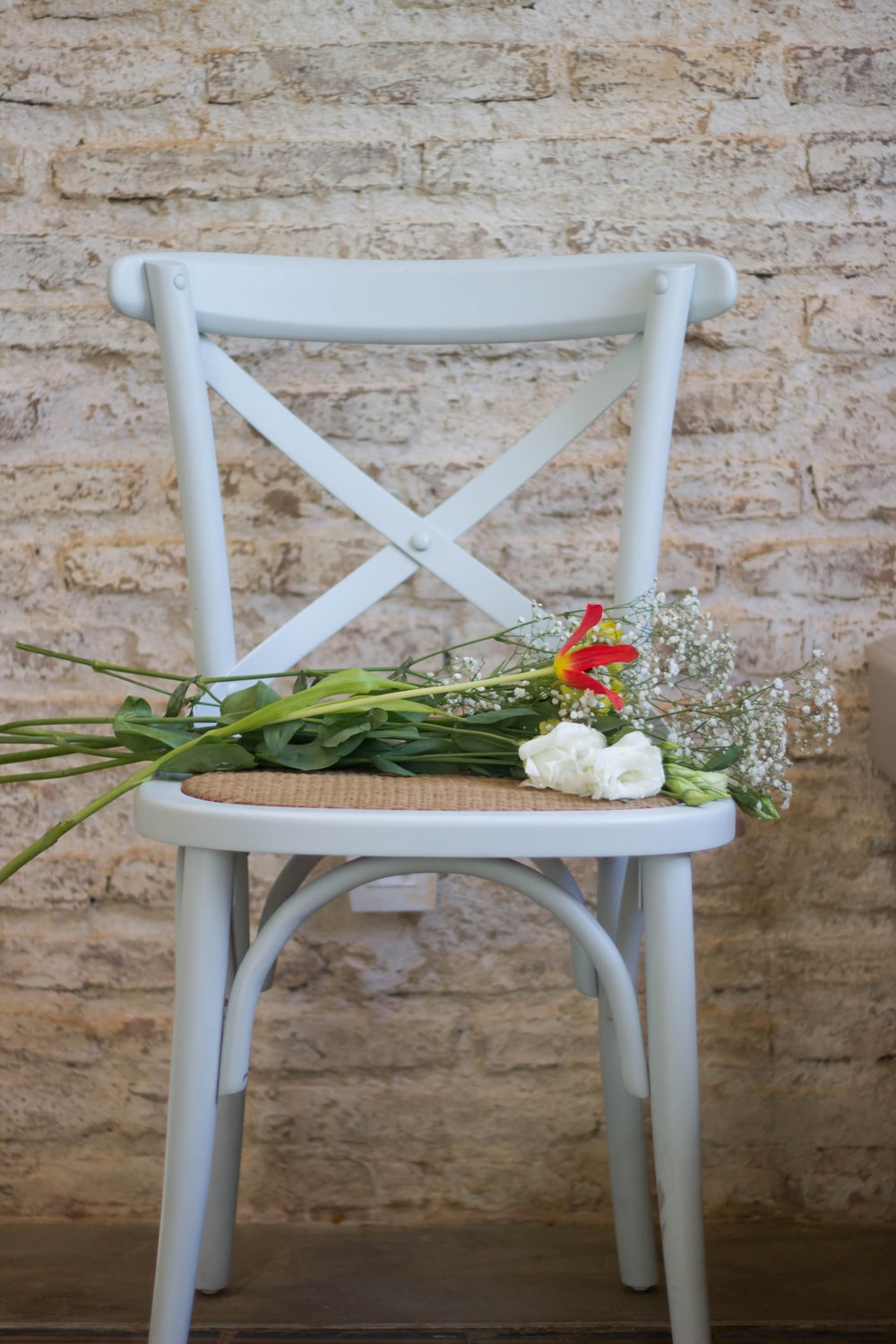 flowers on white wooden armless chair