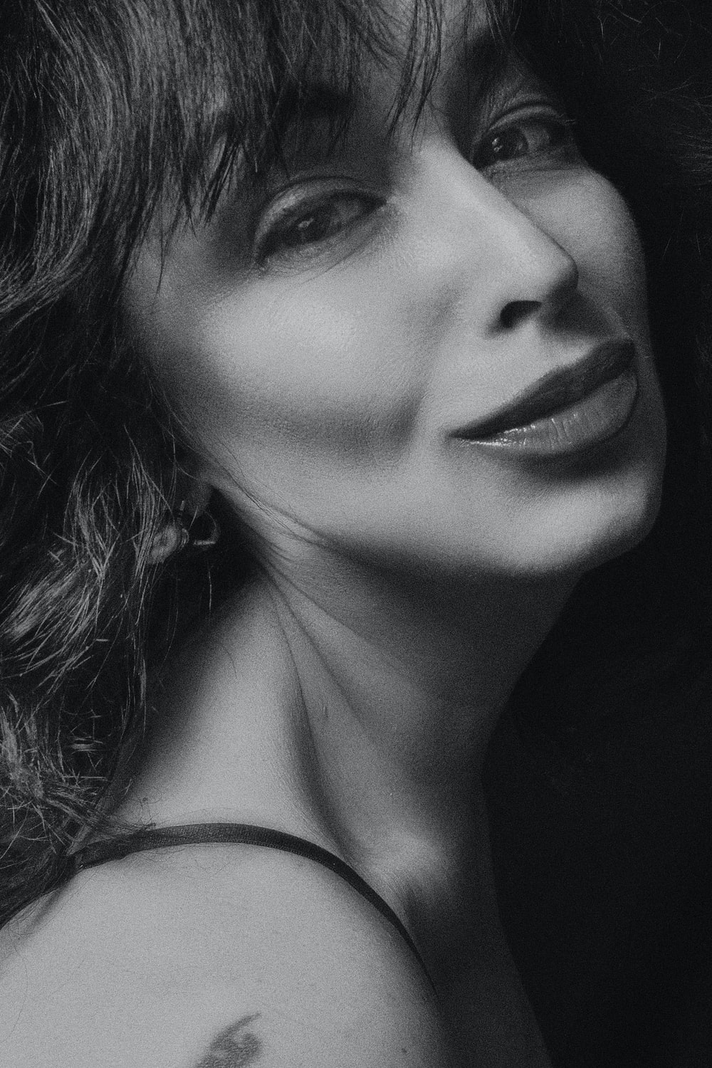 grayscale photography of woman smiling