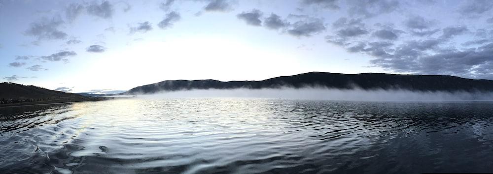 calm body of water panoramic photo