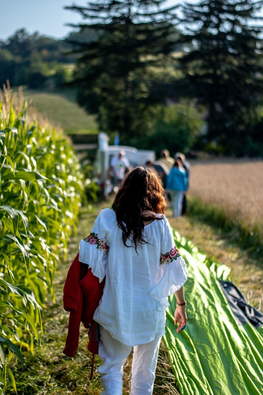 woman beside corn field