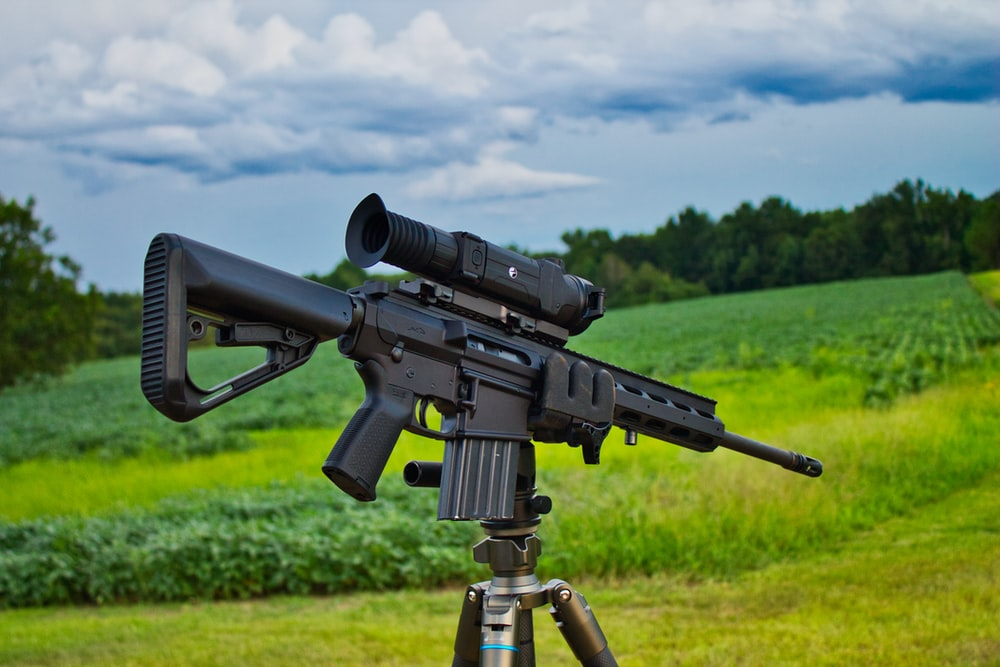 black rifle with scope