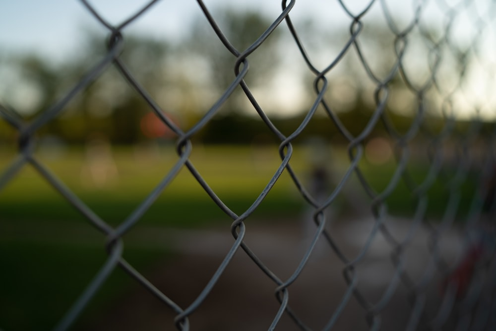 close-up photography of black linked wire fence