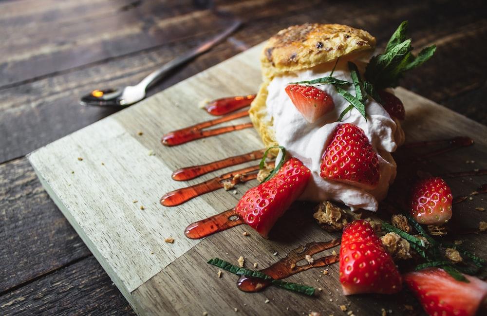 strawberry fruit on chopping board