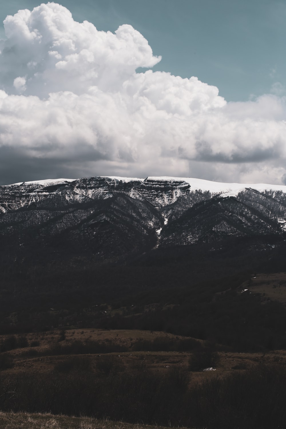 valley under cloudy sky
