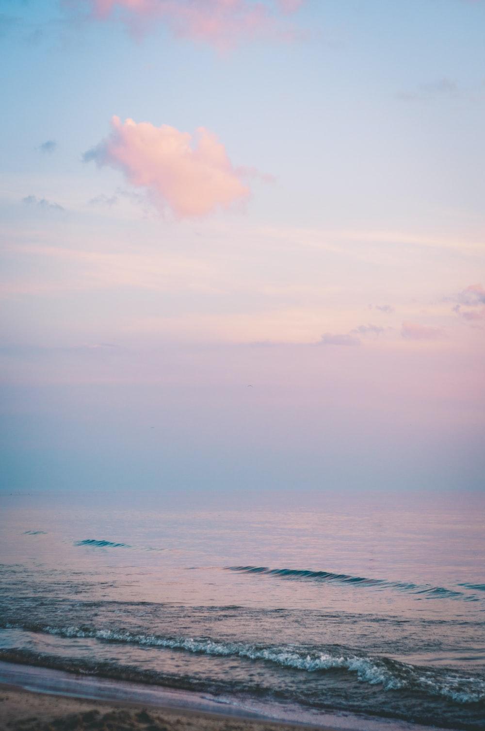 ocean under cloudy sky