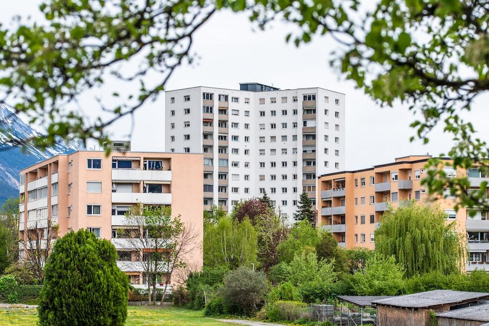 three apartment complex with garden