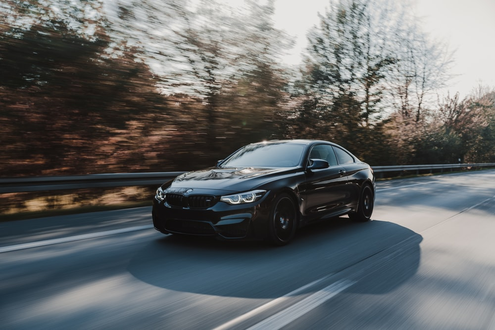 black coupe on road