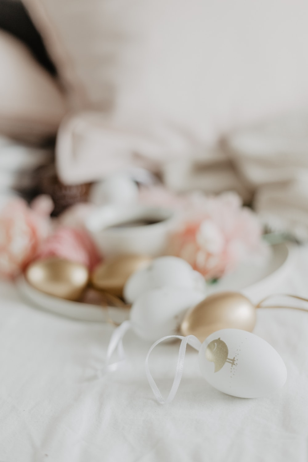white and gold decors on white surface