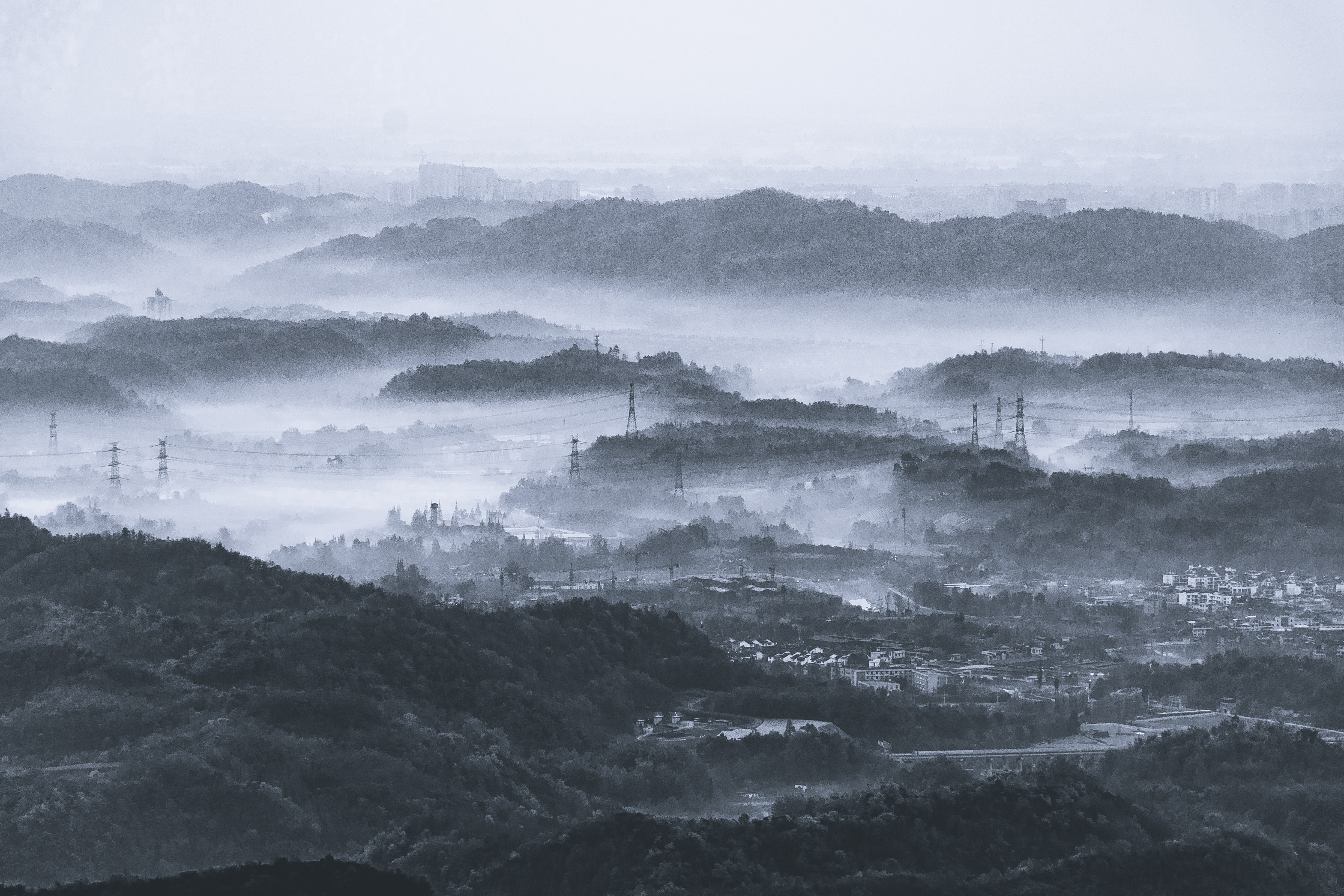 grayscale photo of mountain with fogs