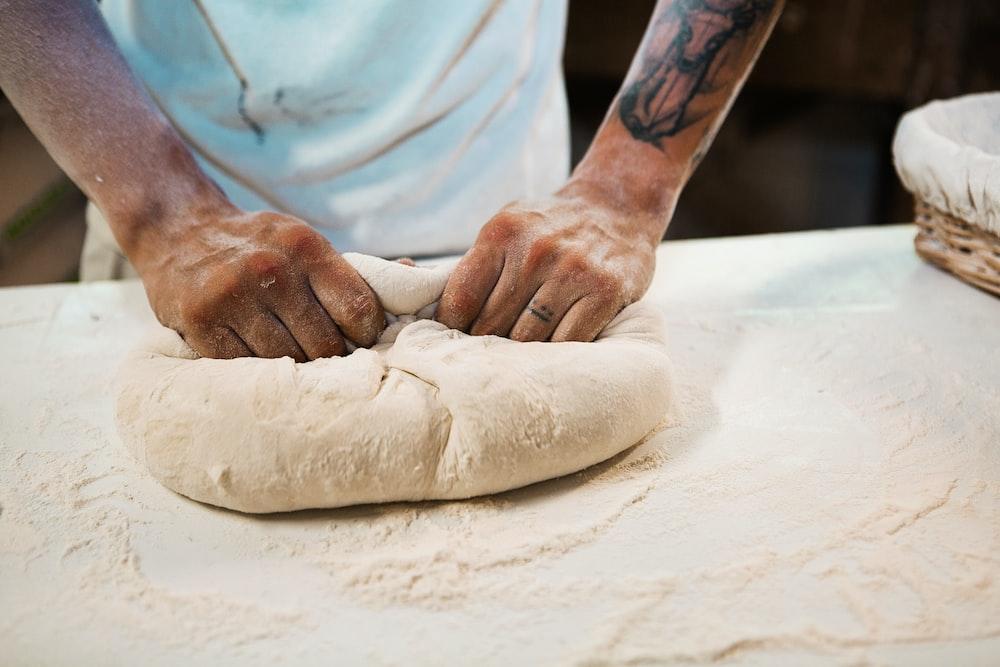 man holding dough