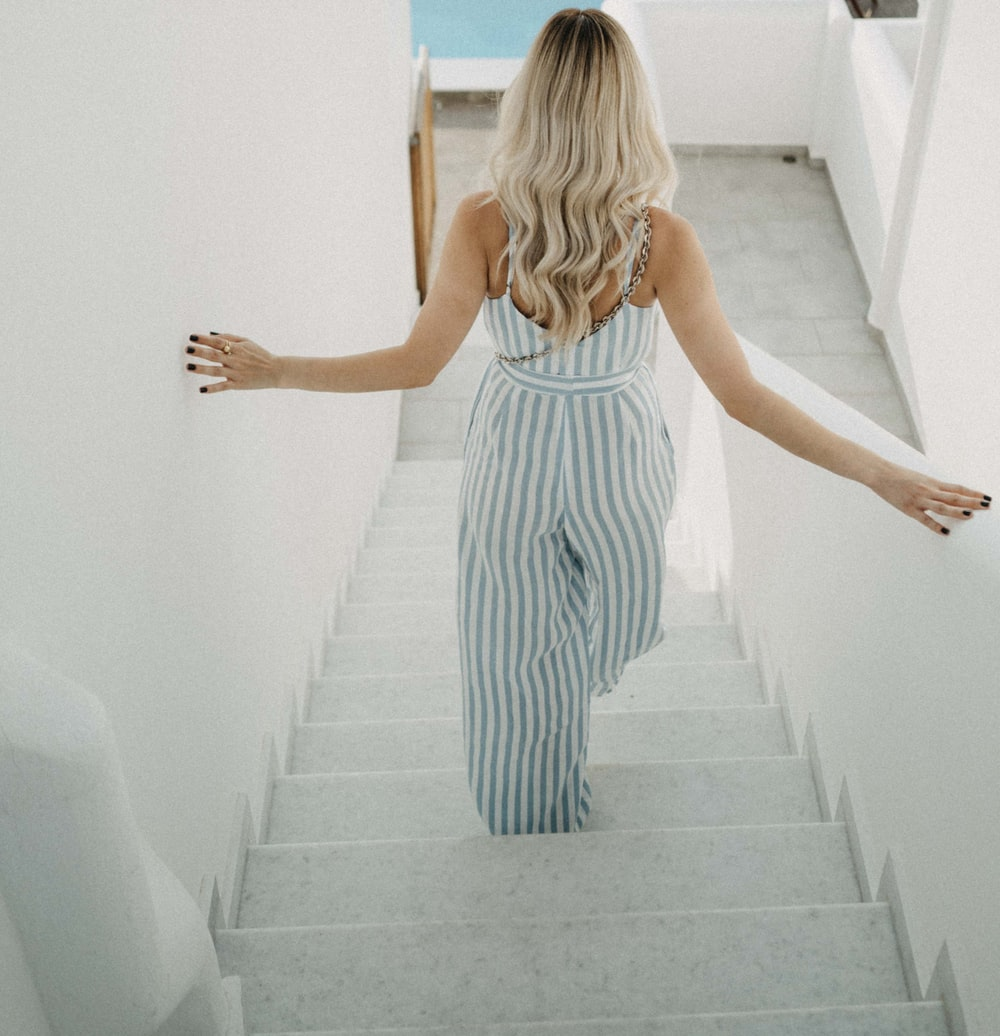 woman wearing gray and white striped rompers