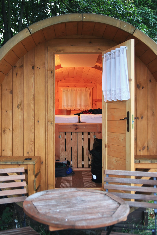 open beige wooden door viewing white mattress