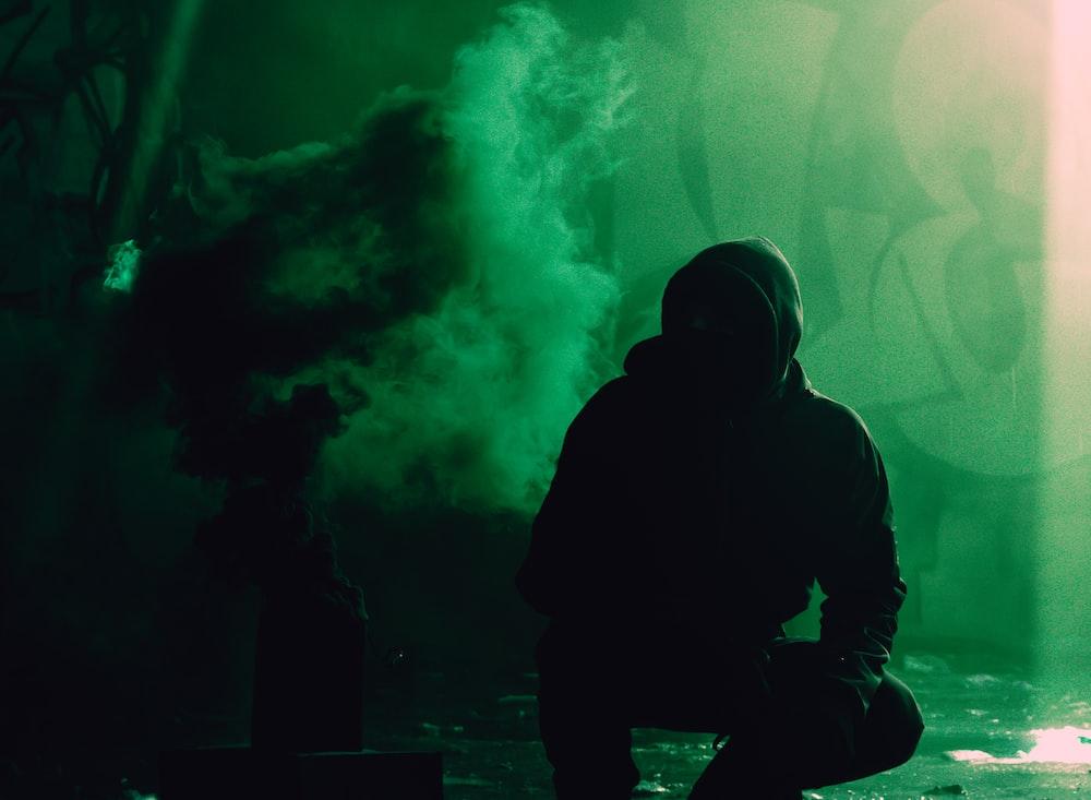 person hoodie beside smoke