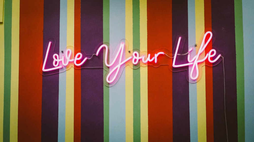 pink love you life neon signage