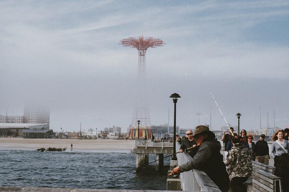 men fishing on pier