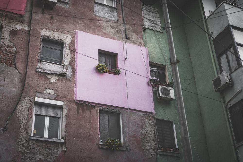 pink and brown wall during daytime