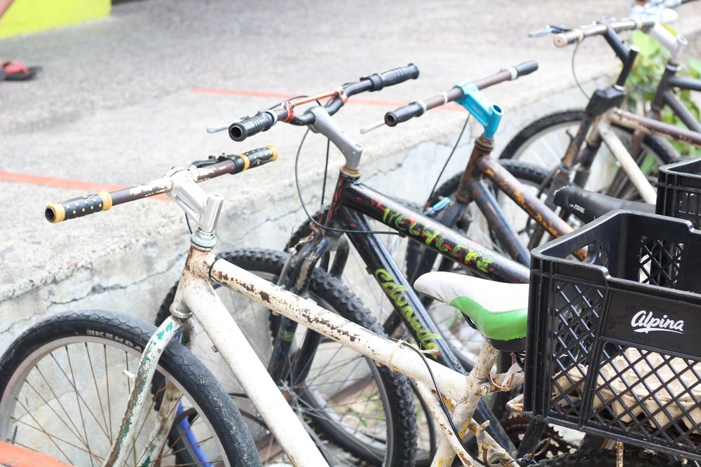 parked mountain bikes with plastic crates