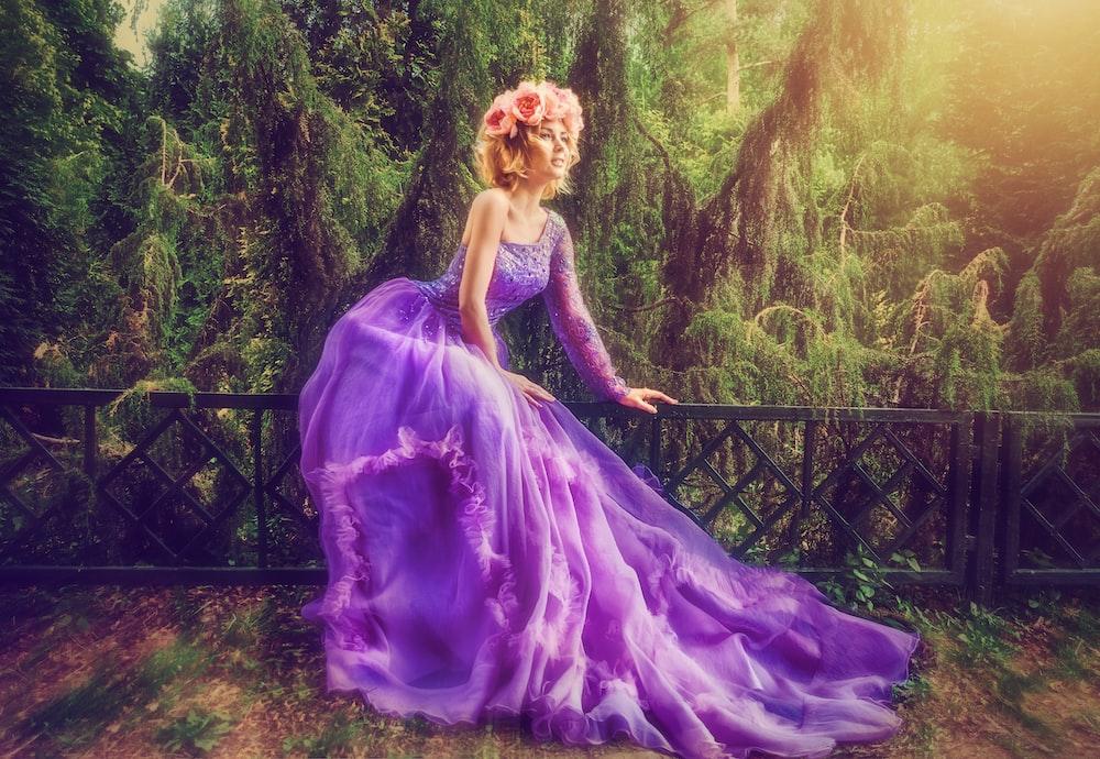 woman wearing purple dress in forest