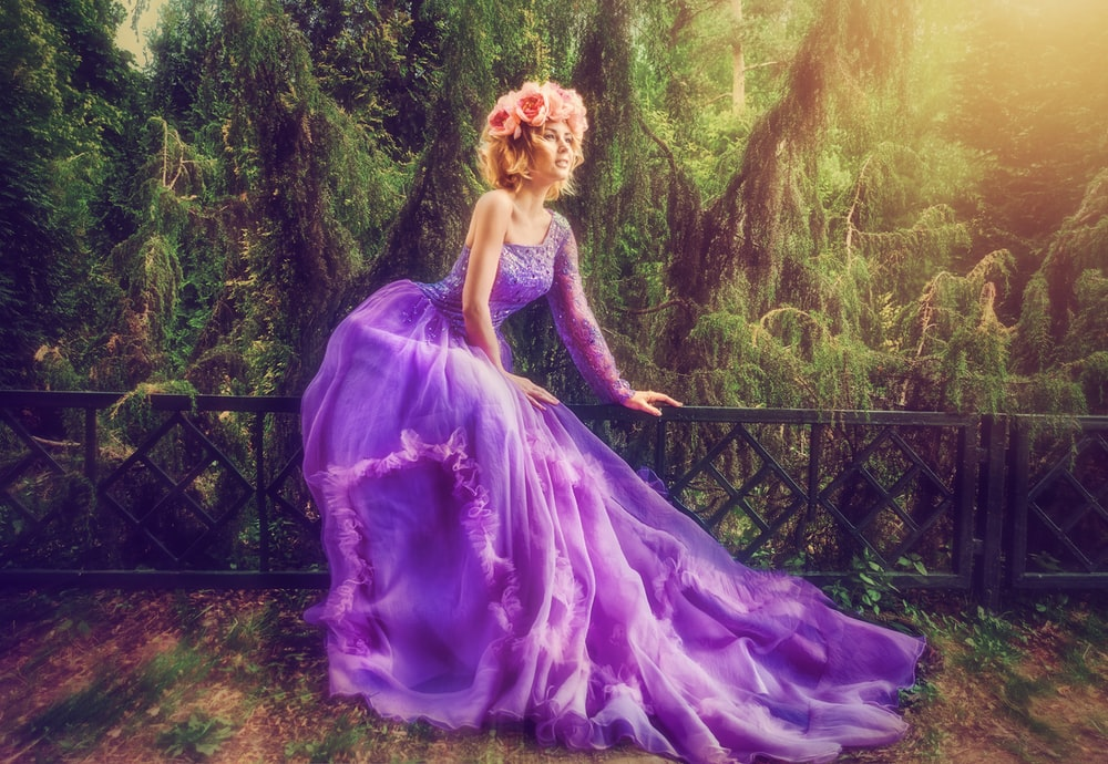 woman wearing purple dress in forest