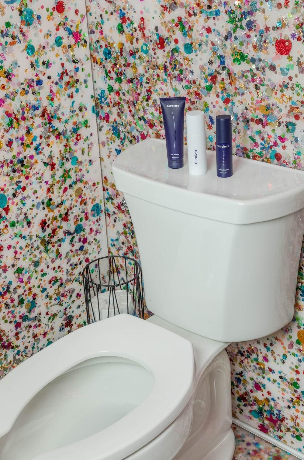 white toilet bowl with cistern