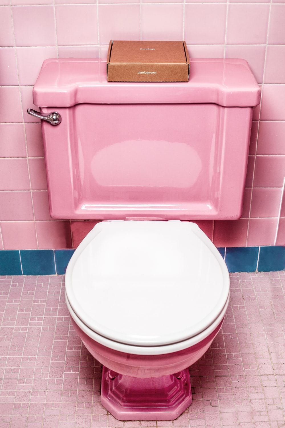 pink and white ceramic toilet bowl