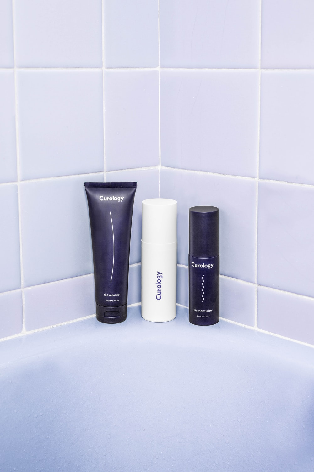 three assorted bath products