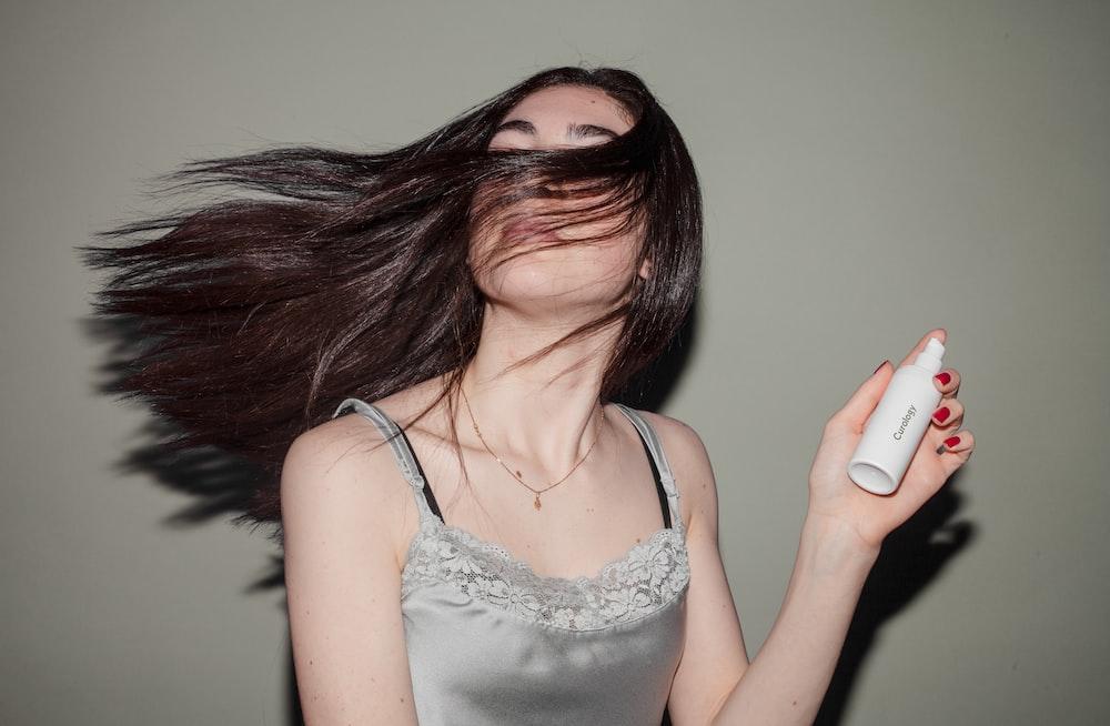 woman holding spray bottle