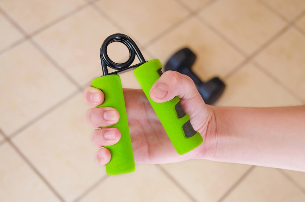 green and black hand grip
