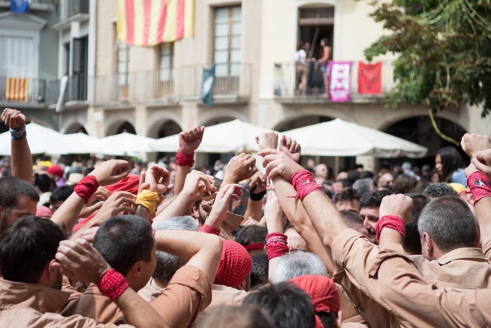 people raising hands \
