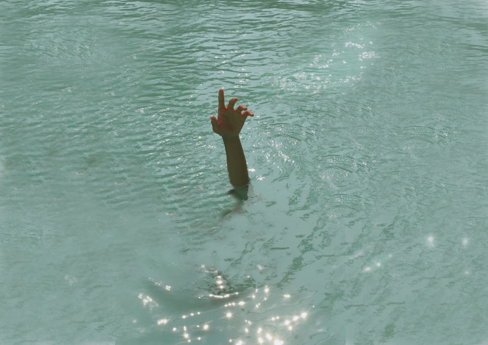 person under body of water