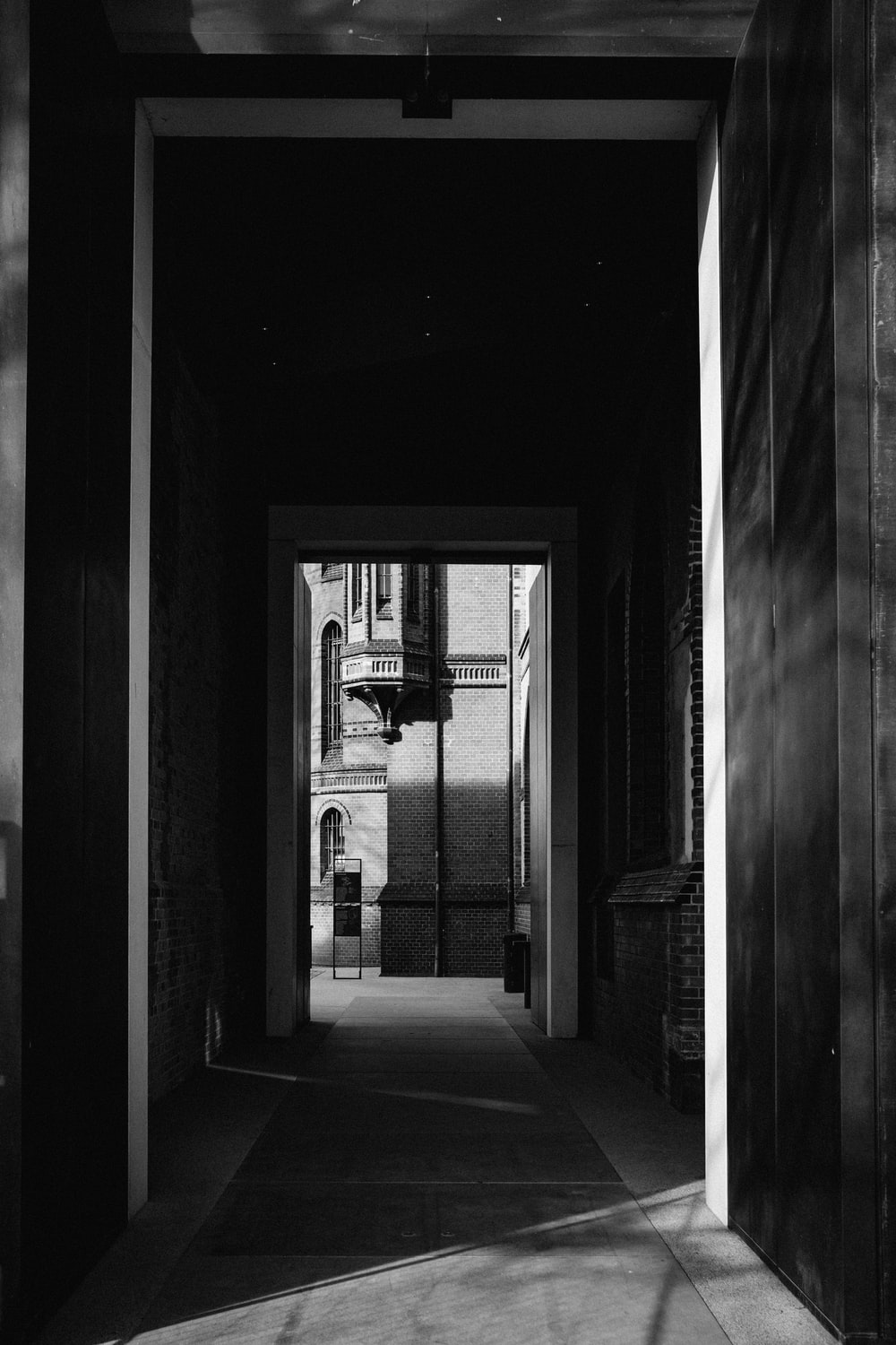 grayscale photography of pathway