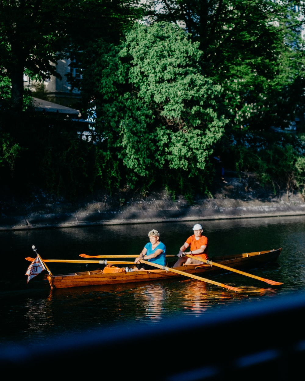man and woman rowing in boat