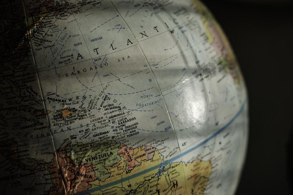 selective focus photo of Atlantic ocean map