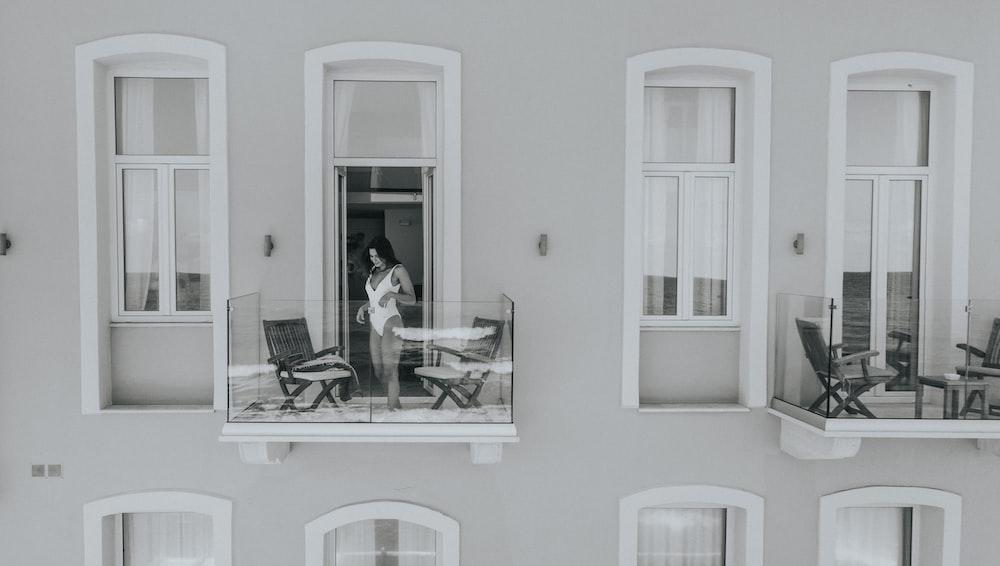 woman in white monokini in building balcony