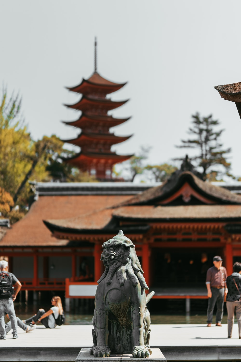 black wolf figurine near pagoda house
