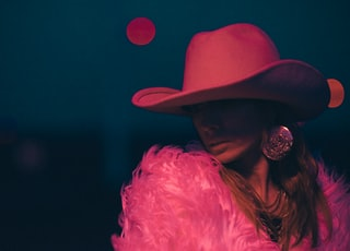 woman wearing pink cowboy hat