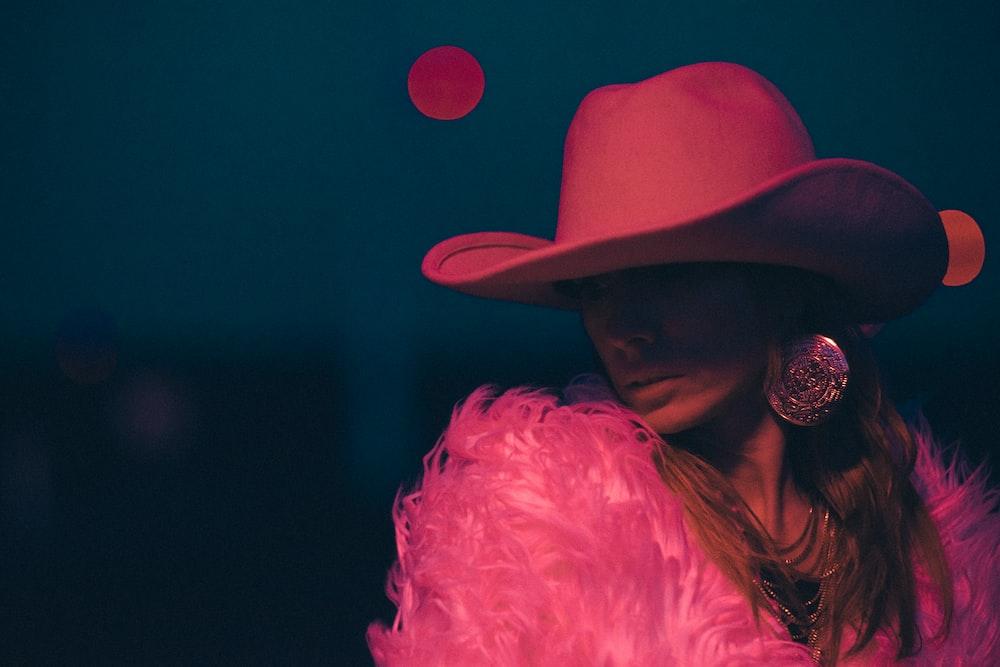 woman wearing pink cowboy hat