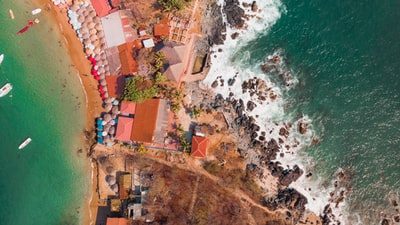 aerial photo of houses in rocky beach zihuatanejo teams background