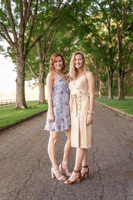 two women standing on street